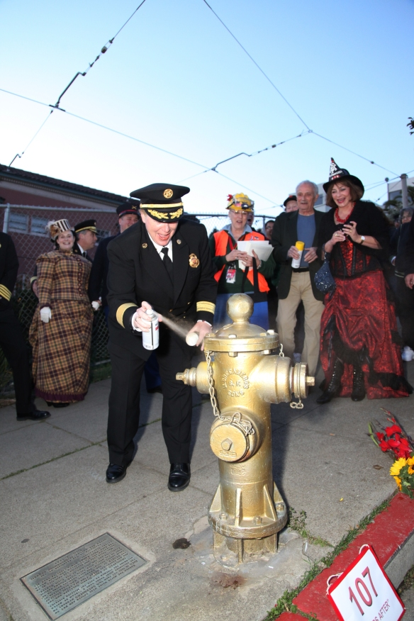 Fire Chief Joanne Hayes-White helping to give the Golden Hydrant, one of the only working hydrants durning the disaster that saved much of the Mission and surrounding areas from fire.